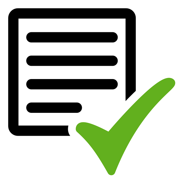 lined paper with green checkmark
