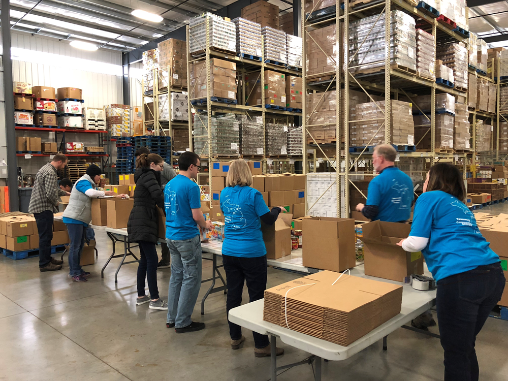 salespage group packing food at kalamazoo loaves and fishes, 2018